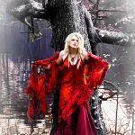 Lady in Red by a tree